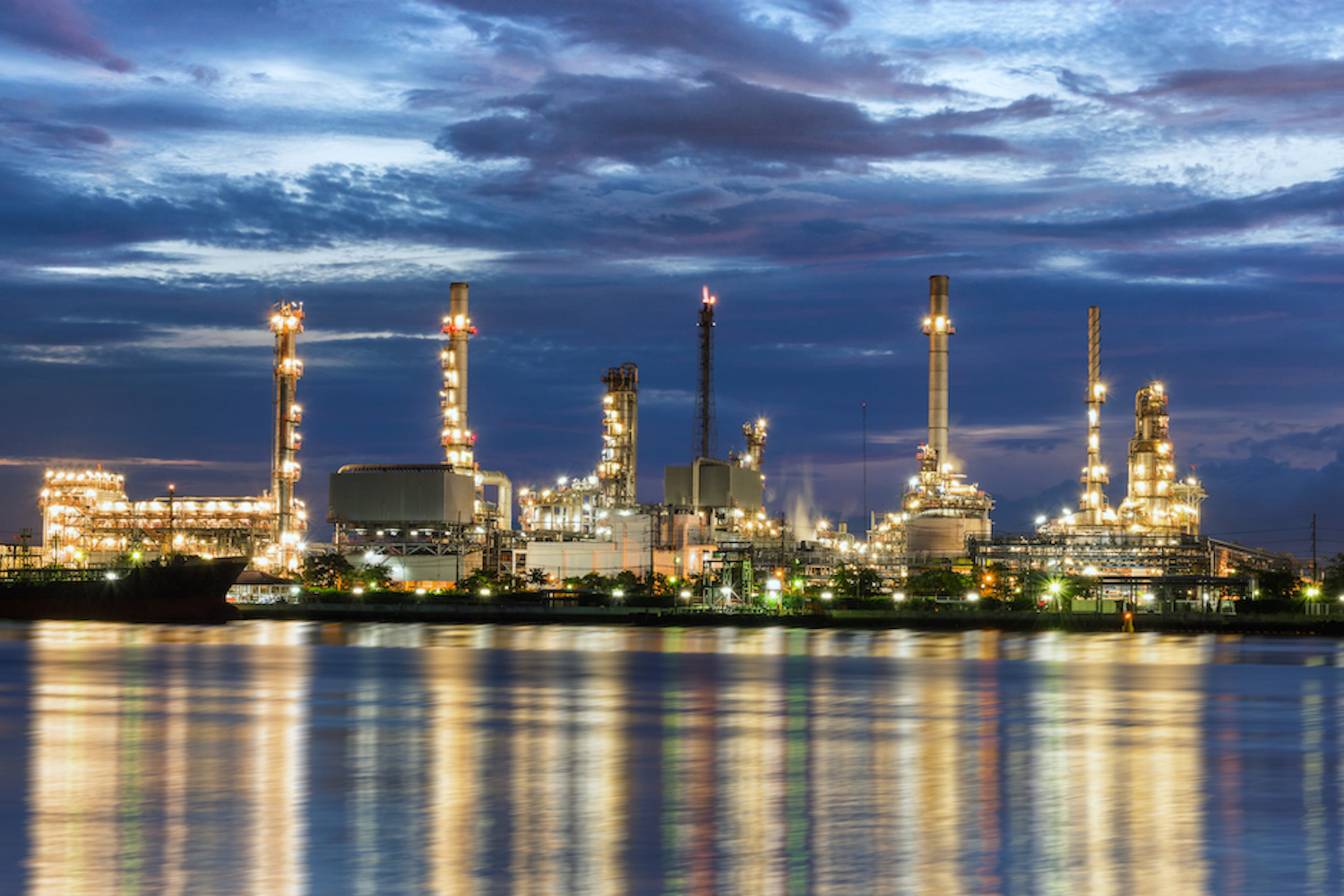 refinery along a river at night